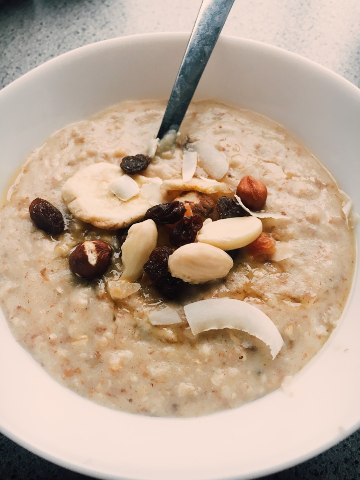 Porridge with fruit, nuts & coconut.