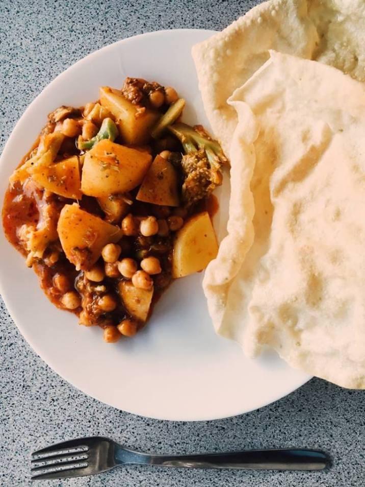 Veg & chickpea tikka masala curry with papadums.